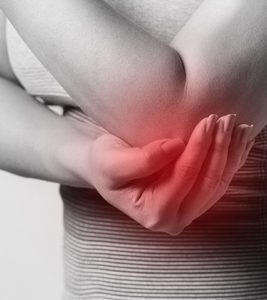 Woman Holds Elbow In Pain