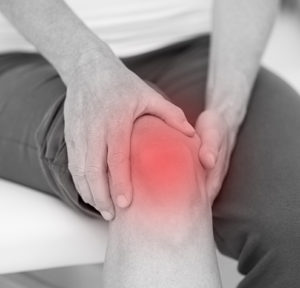 Man Holding Knee In Pain