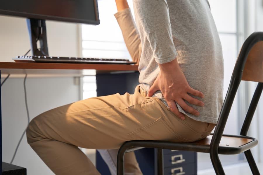 Man experiencing hip pain